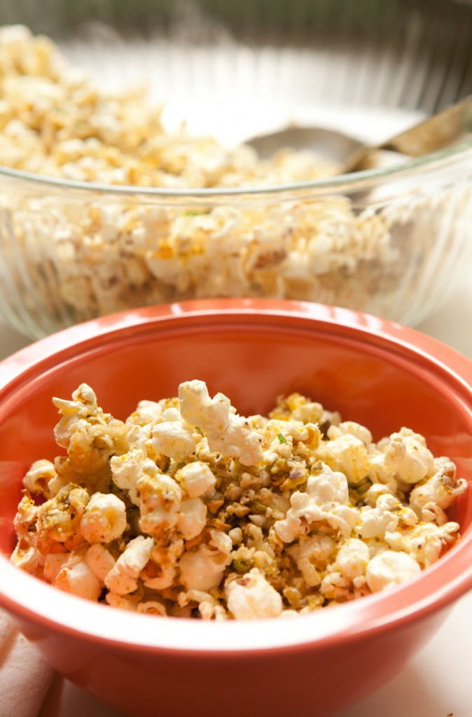 Popcorn is a centuries-old simple food that has gone gourmet. Nutty-cheese popcorn features Parmesan, pistachios and cashews.
