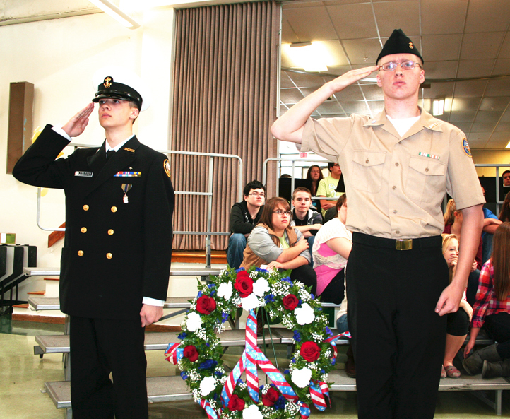 Bonny Eagle High School Navy Junior Reserve Officers Training Corps student members David Emerson, left, and Kiel Carson preside over a wreath ceremony held during the school's annual Veterans Day Celebration. Members of the school's N.J.R.O.T.C. performed a flag-folding ceremony and laid the wreath at the Vietnam Memorial in front of the school. The Bonny Eagle High School band, jazz band and chorus also performed.