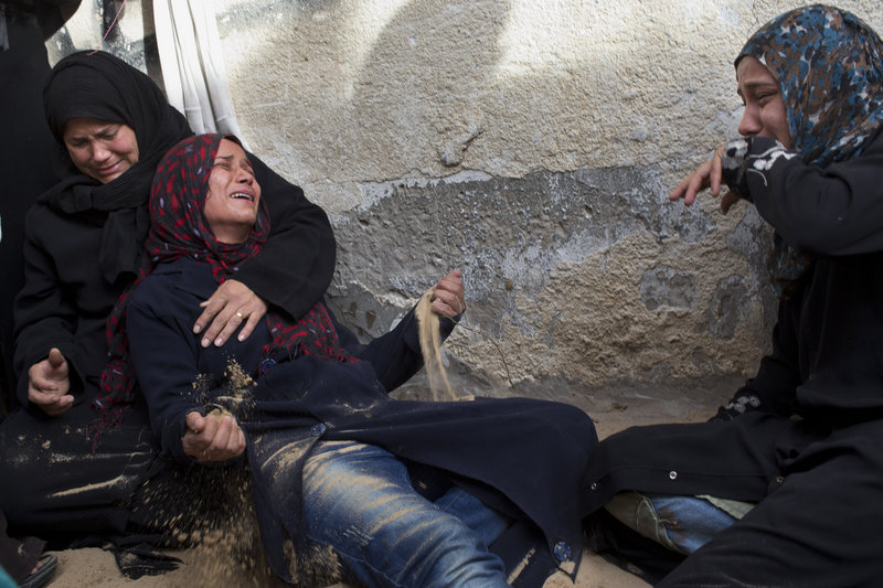 Palestinian women cry at a funeral Friday for two people killed in an Israeli airstrike in Beit Lahia, north Gaza.