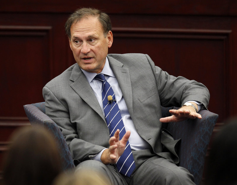 Supreme Court Justice Samuel Alito stands behind the court's 2010 decision that helped fuel hundreds of millions of dollars in campaign spending by independent groups.