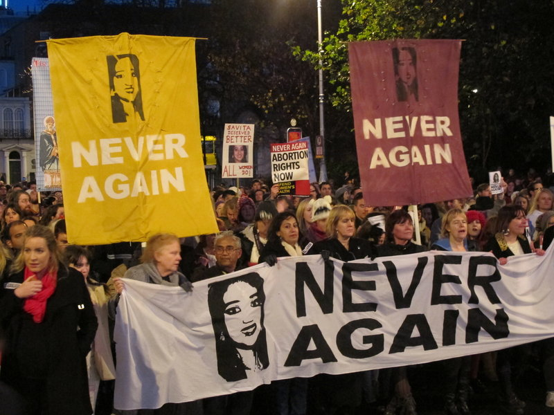 Protesters bearing images of Savita Halappanavar march through Dublin on Saturday to demand that Ireland ensure that abortions can be performed to save a woman's life.
