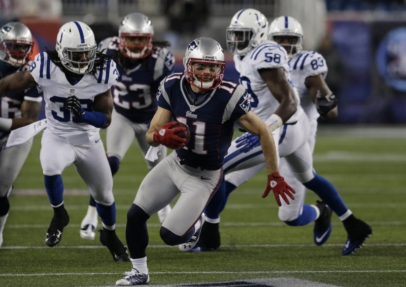 Julian Edelman, playing perhaps his finest game as a Patriot, scoots down the sideline for good yardage during first-half action of Sunday's victory over Indianapolis.