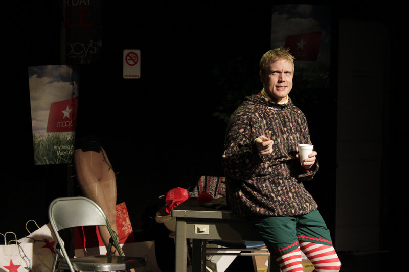 """Dustin Tucker as the much-put-upon elf Crumpet in the Portland Stage Company production of """"The Santaland Diaries,"""" continuing through Dec. 16."""