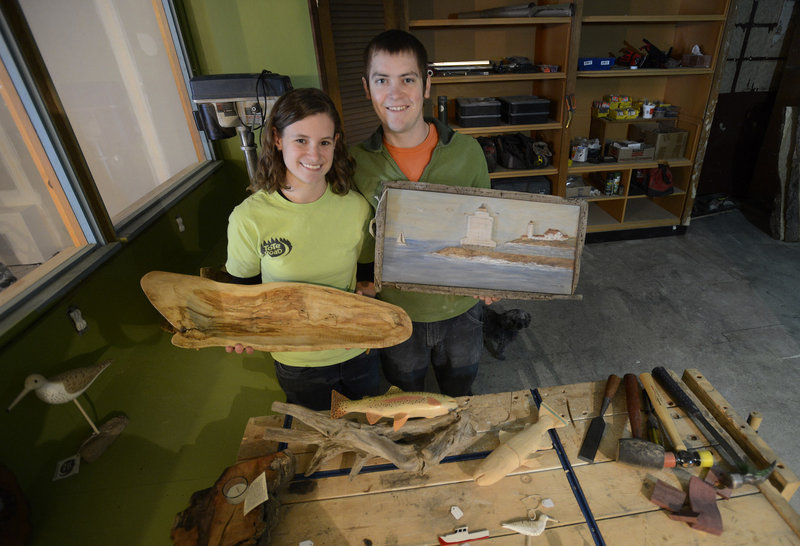 Bekah and David Clark, owners of Tote Road, display their hand-crafted wood products Monday at their downtown location in Biddeford, which has a program to help new businesses get off the ground.