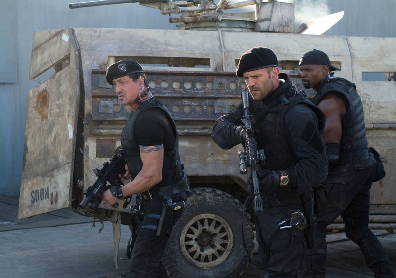 "Sylvester Stallone, left, Jason Statham and Terry Crews in ""The Expendables 2."""