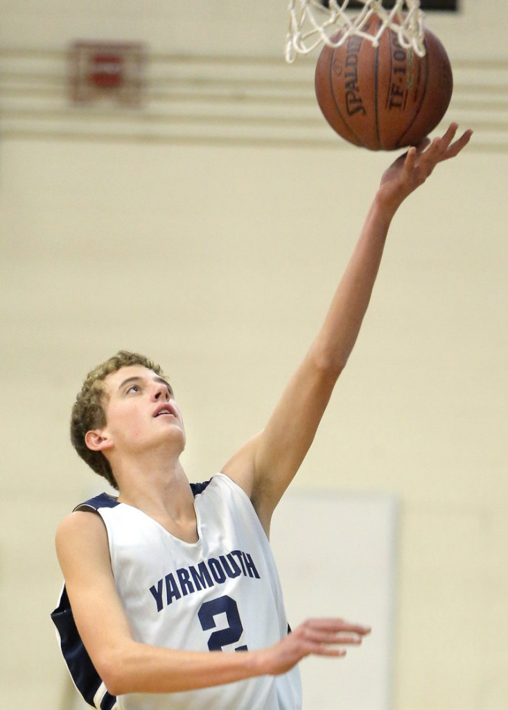 Chase Hughes, now a long and lean senior, goes to the basket uncontested for an easy layup during Monday's practice.