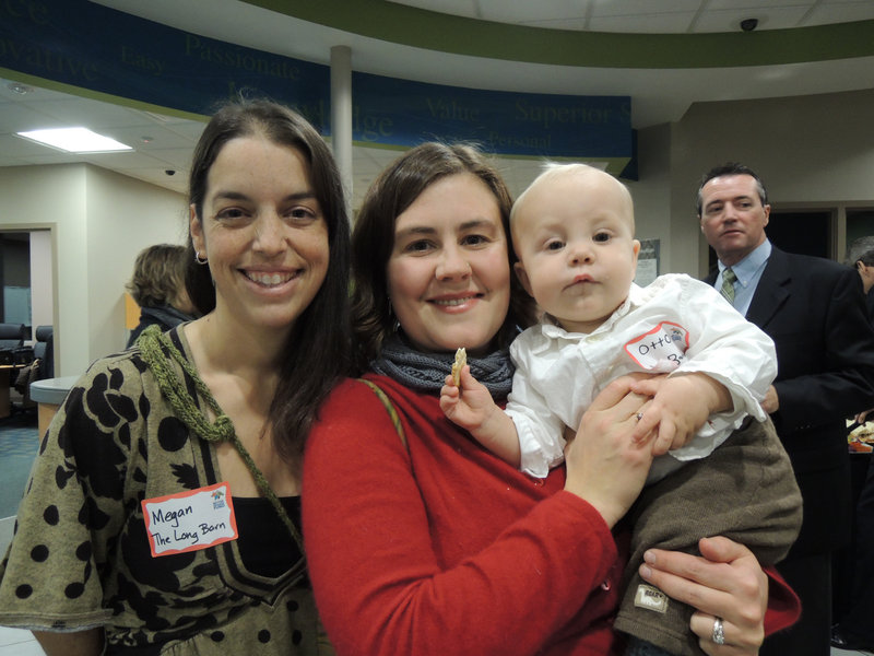 """Megan Dunn and Beatrice Dahlen, co-directors of education at The Long Barn Education Initiative at Broadturn Farm, and baby Otto Dahlen, enjoying reception hors d'oeuvres. Their program received a $5,000 grant for its """"farm to school"""" partnership with the Scarborough Public Schools."""