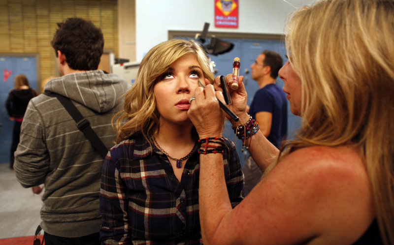 """Jennette McCurdy, as """"Sam Puckett,"""" gets a makeup touch-up during taping on the set of """"iCarly,"""" in Hollywood. The Nickelodeon series is coming to an end after five seasons."""