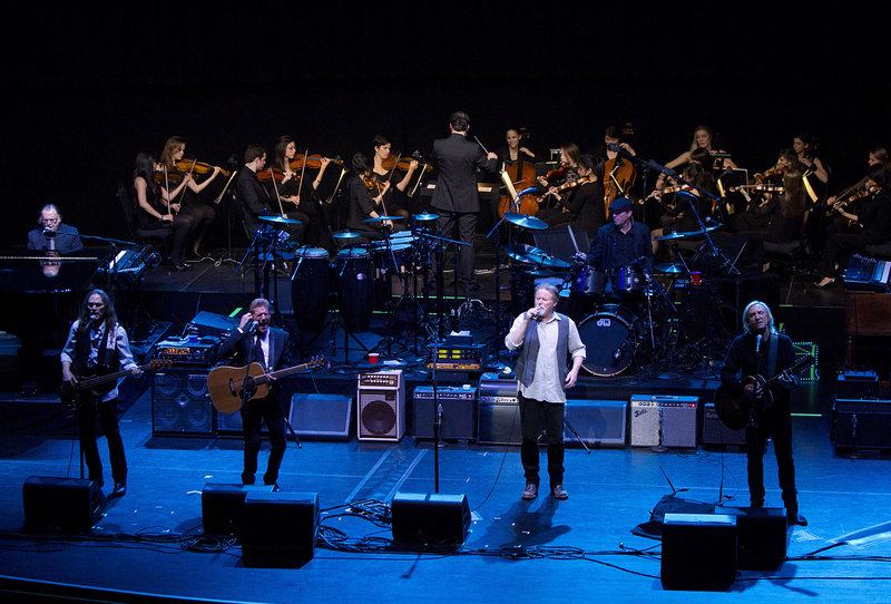 The Eagles, from left, Timothy B. Schmit, Glenn Frey, Don Henley and Joe Walsh perform earlier this month with NYU students at the Beacon Theater.