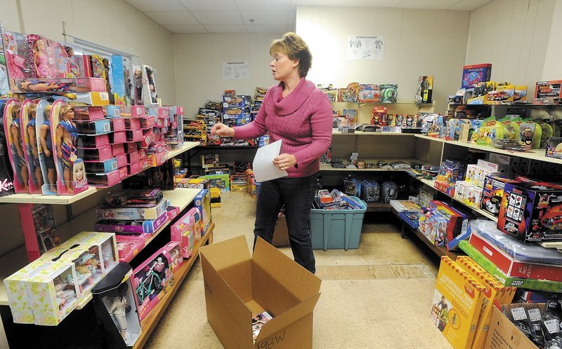 Cristen Sawyer, the Christmas program director at the Maine Children's Home for Little Wanderers in Waterville, prepares Christmas gift boxes for needy children in central Maine.