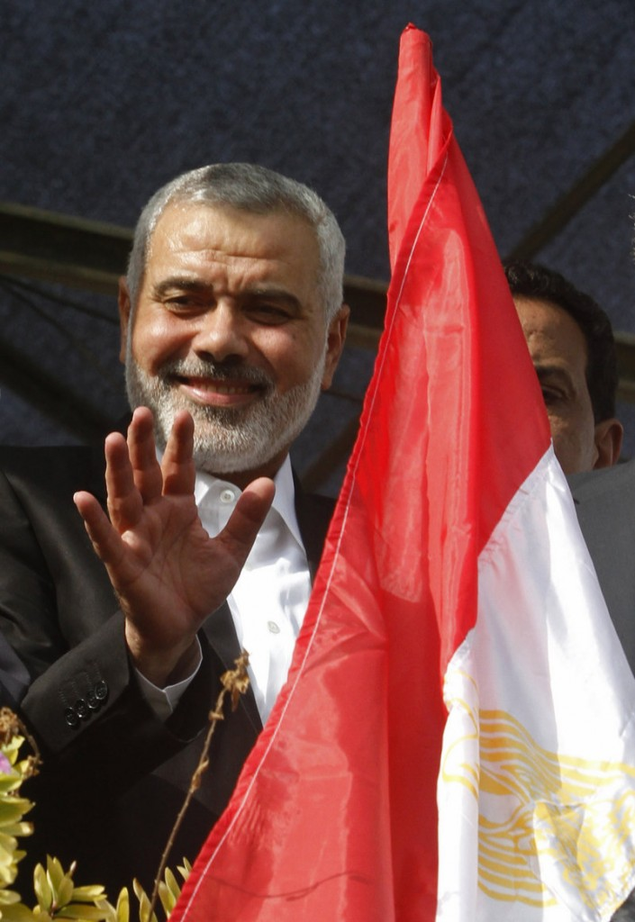 Ismail Haniyeh, Gaza's Hamas prime minister, waves at the crowd while celebrating the cease-fire.