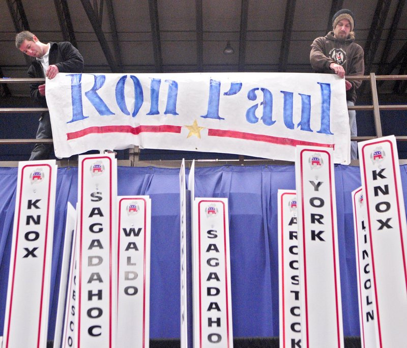 "Backers of presidential candidate Ron Paul hang a sign at the Maine Republican Convention in May. The ""Paulists"" didn't try seriously ""to coordinate party resources for victory in either the U.S. Congress or Maine Legislature,"" thus undermining the prospects of Maine's Republican candidates on Election Day, a reader says."