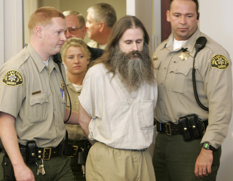 Brian David Mitchell, shown in 2005 entering a Salt Lake City court, is serving two life sentences for then-14-year-old Elizabeth Smart's abduction.
