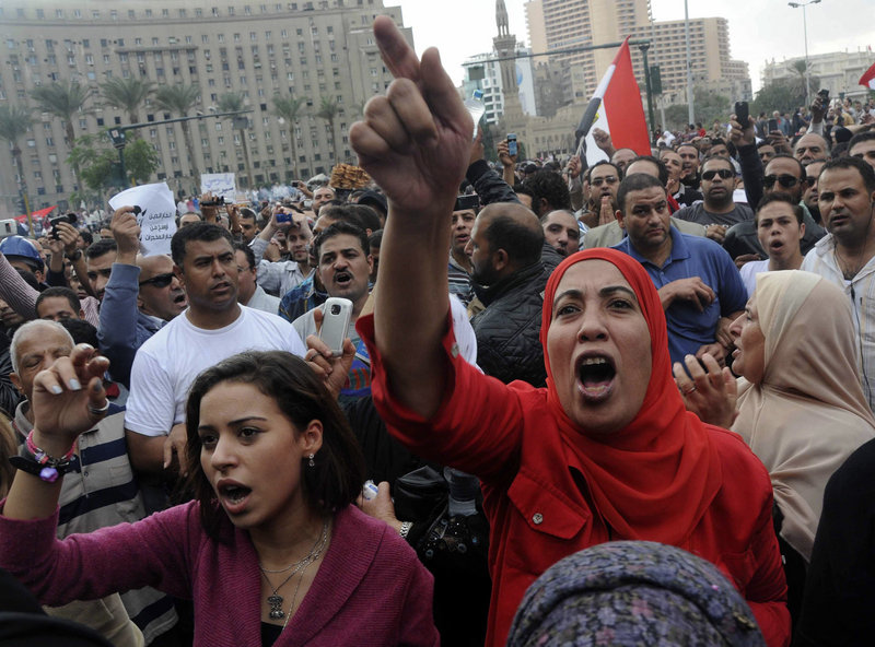 Protesters opposed to President Mohammed Morsi chant slogans in Tahrir Square in Cairo on Friday.