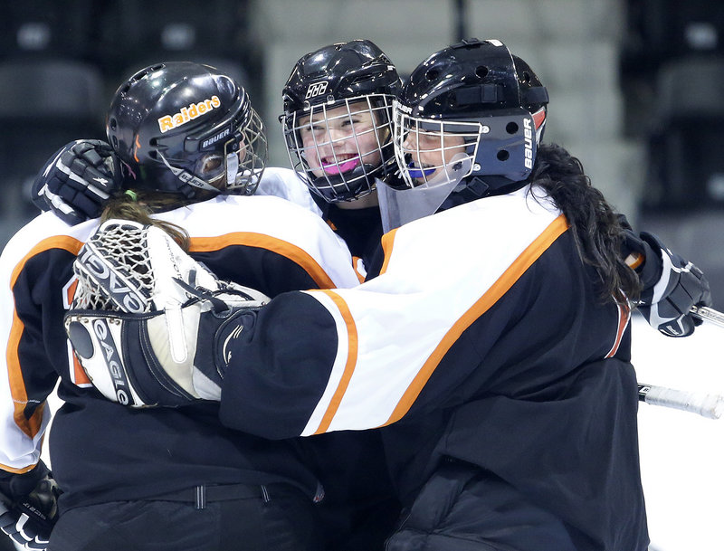 Game over, game won, and the Winslow girls' hockey players were able to celebrate a victory on the road to open the season.