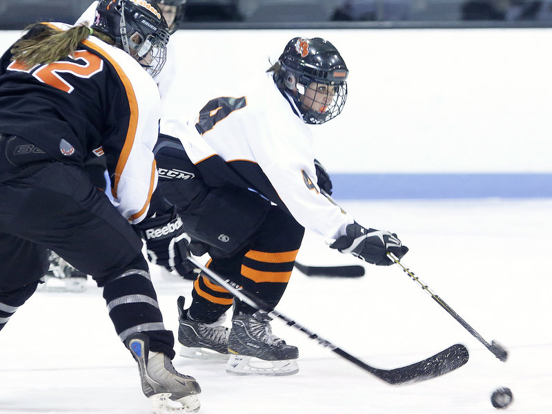 Eliza Brooks of Brunswick gets off a shot ahead of Alexis LaChance of Winslow during Winslow's 4-3 victory Friday night.
