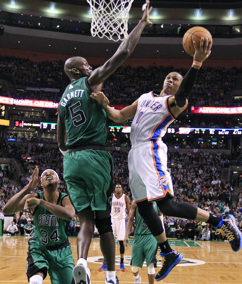Kevin Garnett, Celtics center, defends against Russell Westbrook during Friday's 108-100 victory over Oklahoma City in Boston.