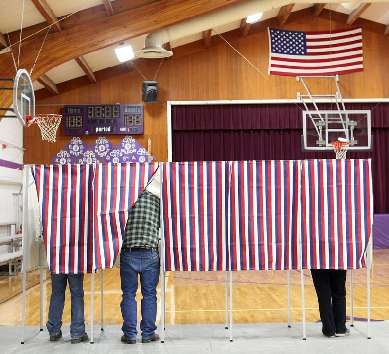 Voters cast their ballots Nov. 6 in Harrison, Mont. For the first time since 1952, a presidential candidate whom men chose decisively lost. Women stuck with President Obama's social safety net versus the rugged individualism of Mitt Romney.