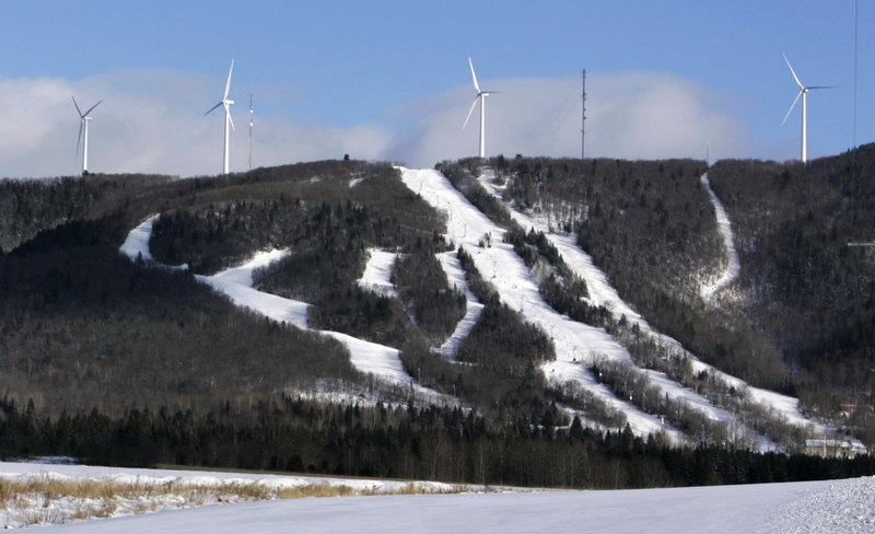 Windmills dot Mars Hills Mountain in Mars Hill. Maine wind developers are working with snowmobilers' groups to make their sites, but not properties, destinations for sledders.