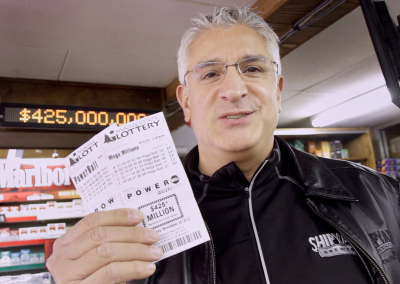 """Paul Sottery of Portland bought his Powerball tickets at Joe's Smoke Shop on Monday morning. Sottery is in charge of The Millionaires Club, a group of 30 people who pool their resources to buy lottery tickets every week. """"Someone is going to win, why not us?"""" he said."""
