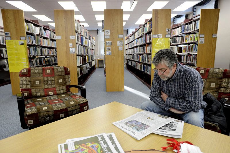 Jim Casey of Cape Elizabeth reads a newspaper at Thomas Memorial Library on Monday, Nov. 26, 2012.