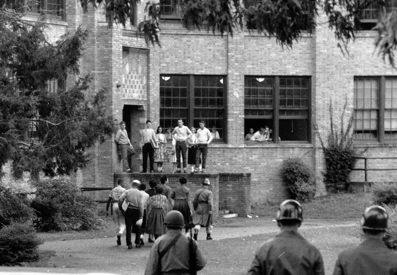 Black students are escorted onto the campus of Central High School in Little Rock, Ark., by an Arkansas National Guard officer Oct. 15, 1957. To desegregate the school, President Eisenhower, a Republican, sent Army troops there and put the Guard under federal command.