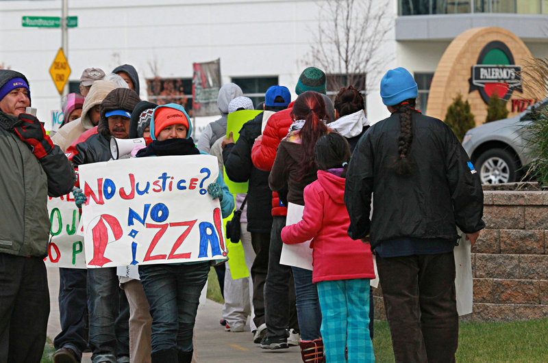 Workers picket recently at Palermo's Pizza, a frozen pizza manufacturer in Milwaukee, Wis., where efforts to form a union have clashed with immigration enforcement and drawn national attention along with a boycott.