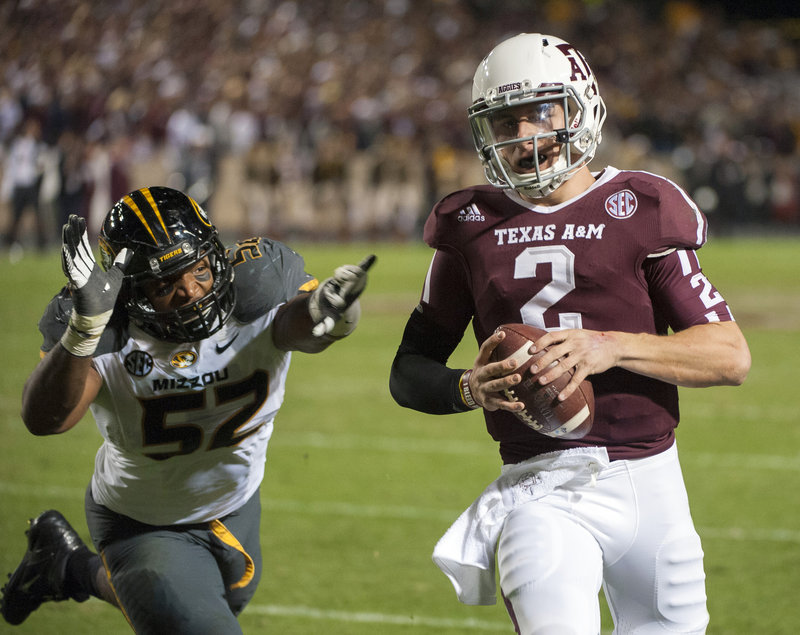 """Johnny Manziel of Texas A&M, shown evading Missouri's Michael Sam during last weekend's 59-29 victory, could soon be the first freshman – albeit not a """"true"""" one – to win the coveted Heisman Trophy."""