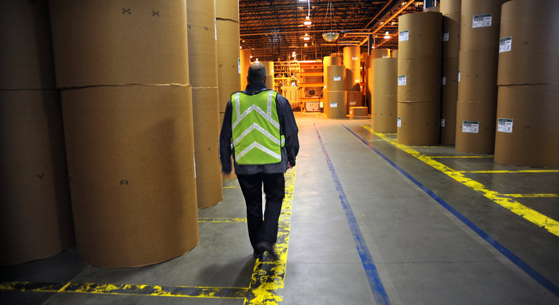 Finished paper is stored in rolls at the UPM Blandin paper mill in Grand Rapids, Minn. Demand for paper has been falling for years, and analysts predict another 18 percent dropoff by 2024. In Maine, the industry employs roughly 7,400 people, about half the number of a decade ago.