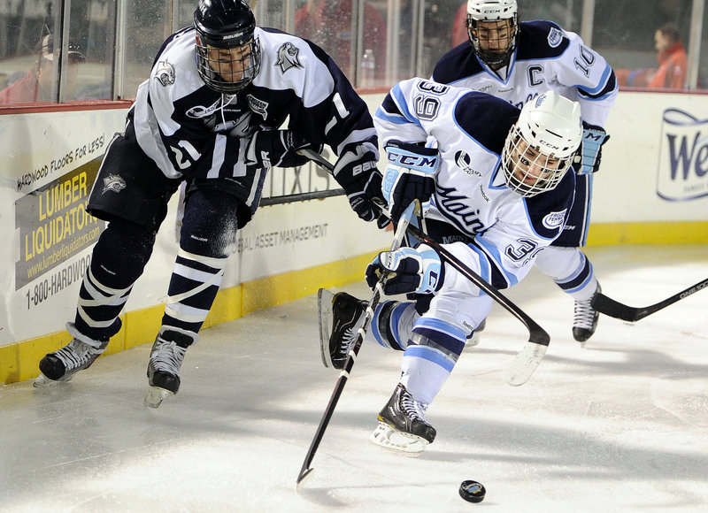 """Joey Diamond, right, is never lacking for hard-nosed hustle when he's on the ice – a style he's had since Pee Wee hockey growing up in Long Island, N.Y. """"Pound for pound, without a doubt, he's the toughest player I've ever coached,"""" said Maine Coach Tim Whitehead."""