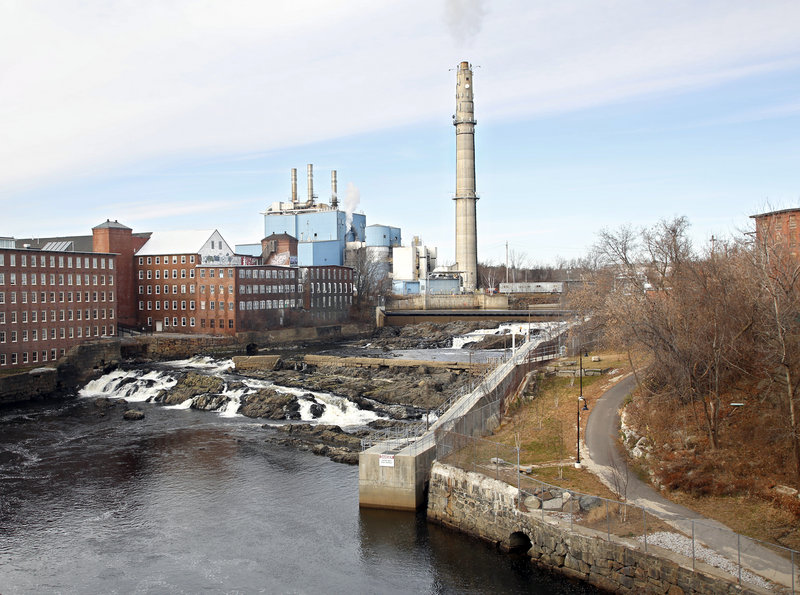 Biddeford purchased the Maine Energy Recovery Co. property Friday, sealing a historic deal that many hope will bring new life to a downtown dominated by a trash incinerator for the past 25 years