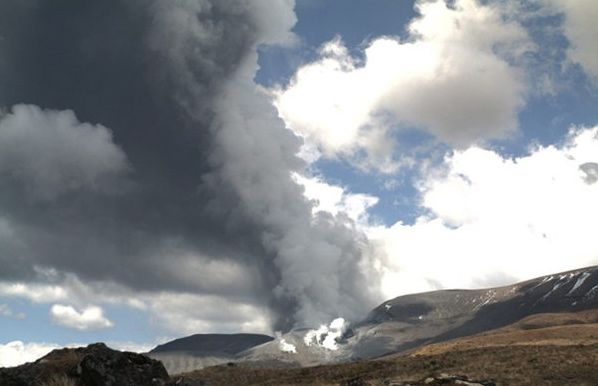 In this photo released by the Institute of Geological and Nuclear Sciences smoke billows out of Te Maari crater on Mount Tongariro, New Zealand, after a brief eruption Wednesday.