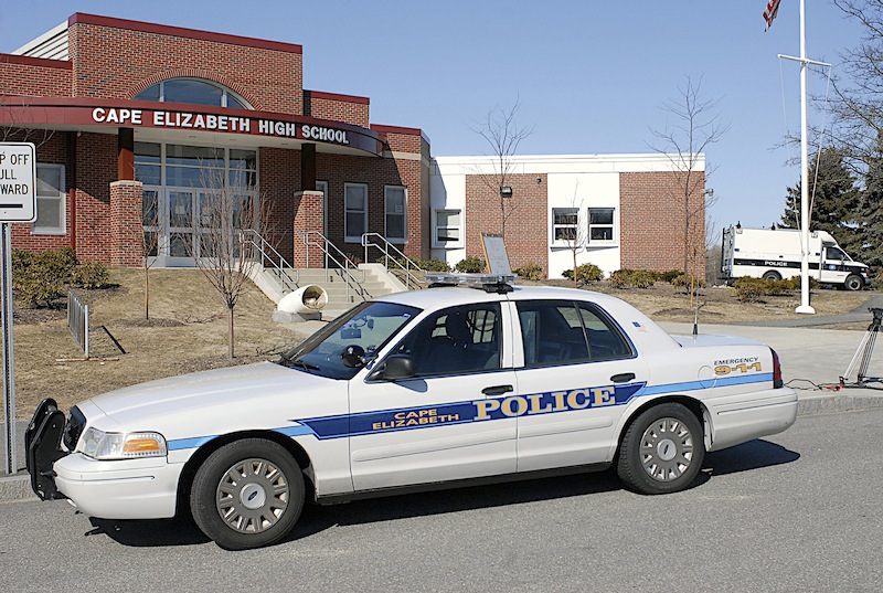 In this March 2008 file photo, a police cruiser sits in front of Cape Elizabeth High School. Police are investigating a Friday, Dec. 10, 2012 marijuana-cookie incident that has led to the suspension of nine Cape Elizabeth High School students.