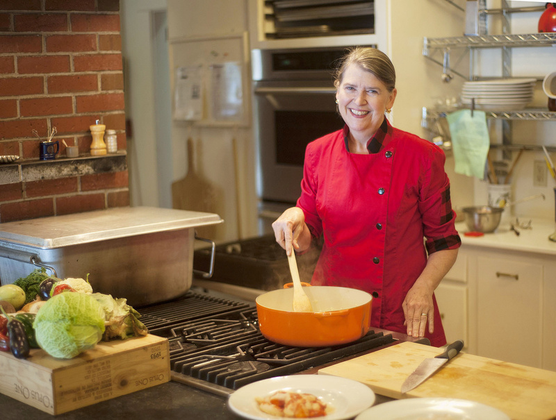Cheryl Wixson works in the kitchen of her Bangor home to produce hand-crafted prepared foods, such as pasta sauce, applesauce, ketchup, relish, jam, etc., in small batches using all Maine ingredients.