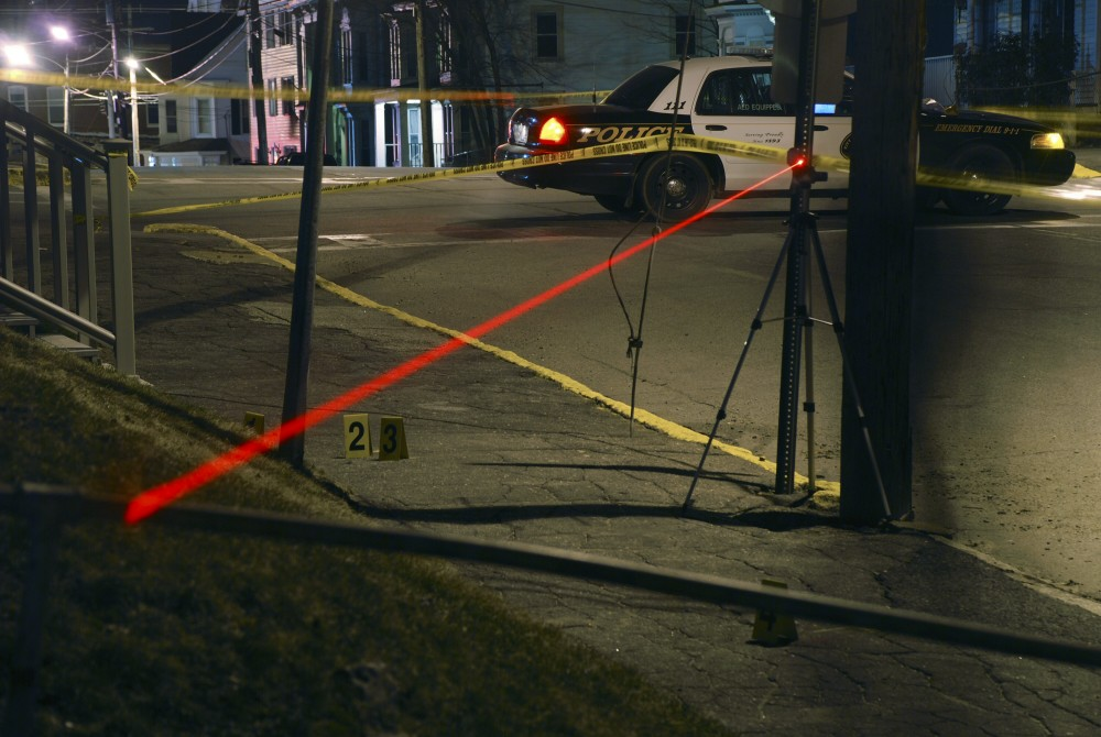 Investigators working with the Maine Attorney General's Office use lasers to map the path of bullets fired in the police shooting of Barbara Stewart of Biddeford on March 24, 2009. Photo is from the AG's investigative case file on the shooting.