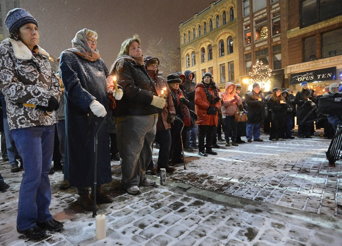 """Participants in Sunday's vigil in Portland called for stricter rules on gun sales. """"People don't need an assault rifle to hunt or to protect themselves,"""" said Mayor Michael Brennan."""