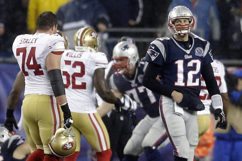 New England Patriots quarterback Tom Brady (12) walks toward the sideline in the second quarter of an NFL football game against the San Francisco 49ers in Foxborough, Mass., Sunday, Dec. 16, 2012. (AP Photo/Elise Amendola) NFLACTION12; Gillete Stadium