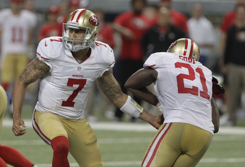 San Francisco 49ers quarterback Colin Kaepernick, left, hands off to running back Frank Gore during the second quarter of an NFL football game against the St. Louis Rams Sunday, Dec. 2, 2012, in St. Louis. (AP Photo/Seth Perlman) Edward Jones Dome