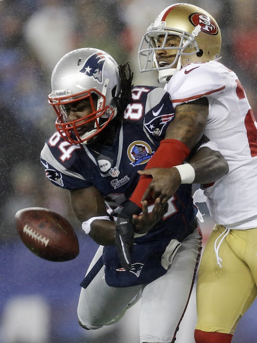 San Francisco 49ers cornerback Tarell Brown, right, breaks up a pass in the end zone intended for New England Patriots wide receiver Deion Branch (84) in the second quarter of an NFL football game in Foxborough, Mass., Sunday, Dec. 16, 2012. (AP Photo/Elise Amendola) NFLACTION12; Gillete Stadium