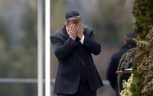 A mourner arrives at the funeral service for 6-year-old Noah Pozner in Fairfield, Conn., on Monday. Pozner was one of 26 people killed in Friday's mass shooting.