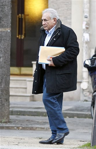 Former International Monetary Fund leader Dominique Strauss-Kahn leaves his apartment building in Paris on Monday.