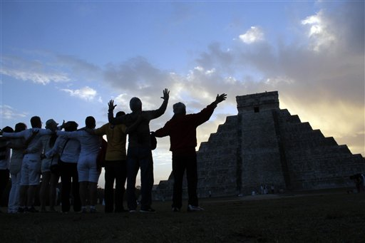 People gesture toward the the Kukulkan temple in Chichen Itza, Mexico on Friday.
