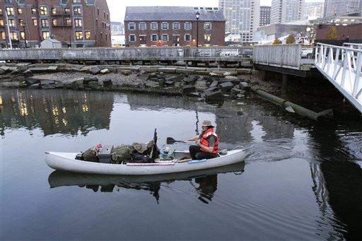 Michael Richard Smith pilots his canoe in Boston Harbor on Tuesday.