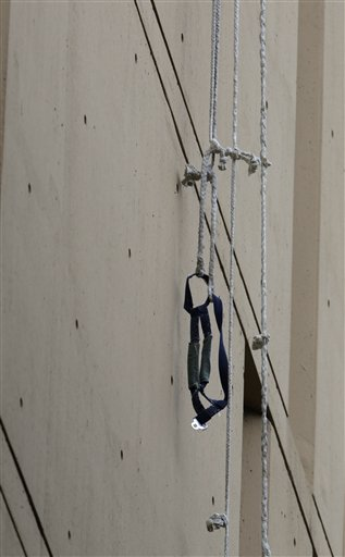 A harness and the end of a rope dangles from a window on the back side of the Metropolitan Correctional Center on Tuesday in Chicago.