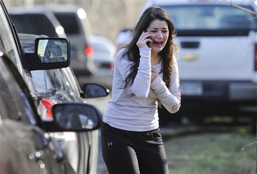 A woman waits to hear about her sister, a teacher, following a shooting at the Sandy Hook Elementary School in Newtown, Conn., on Friday.