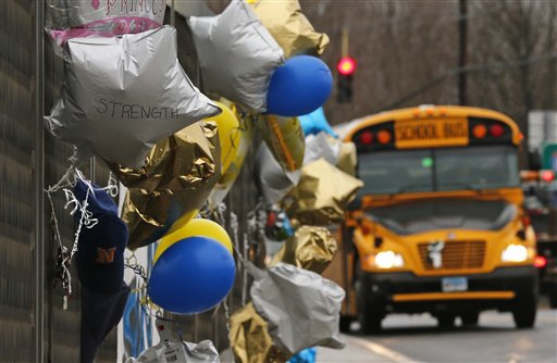 Classes resumed Tuesday for Newtown schools except those at Sandy Hook. Buses ferrying students to schools were festooned with large green and white ribbons on the front grills, the colors of Sandy Hook. At Newtown High School, students in sweatshirts and jackets, many wearing headphones, betrayed mixed emotions.