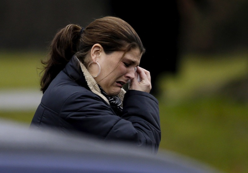 A mourner leaves the funeral service of Sandy Hook Elementary School shooting victim, Jack Pinto, 6, Monday, Dec. 17, 2012, in Newtown, Conn. Pinto was killed when a gunman walked into Sandy Hook Elementary School in Newtown Friday and opened fire, killing 26 people, including 20 children. (AP Photo/David Goldman)