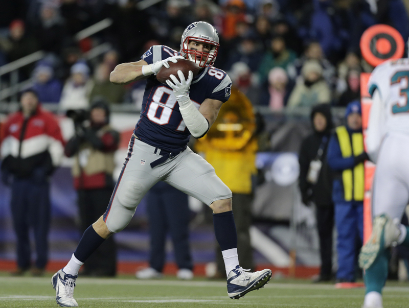 Patriots tight end Rob Gronkowski (87) makes a catch that he ran in for a touchdown during the fourth quarter of Sunday's game against the Miami Dolphins in Foxborough, Mass. Gronkowski was back on the field after missing five games.