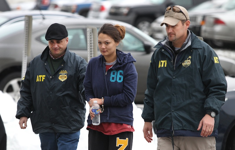 Dawn Nguyen is escorted into the Federal Building, Friday, Dec. 28, 2012, in Rochester, N.Y., and charged in connection with the guns used in the Christmas Eve ambush slaying of two volunteer firefighters responding to a house fire in Webster, N.Y. (AP Photo/Democrat & Chronicle, Jamie Germano)