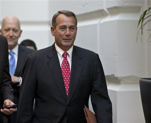 Speaker of the House John Boehner, R-Ohio, arrives for a closed-door meeting with House Republicans as he negotiates with President Obama to avert the fiscal cliff, at the Capitol in Washington, Tuesday, Dec. 18, 2012. More than 7,000 Maine residents could be among the first Americans to fall off the